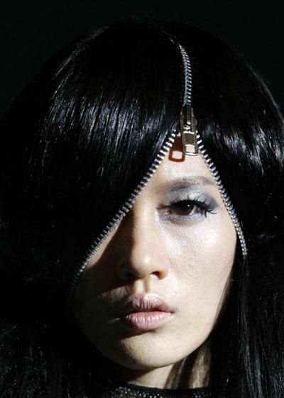 A model presents a hairdo during