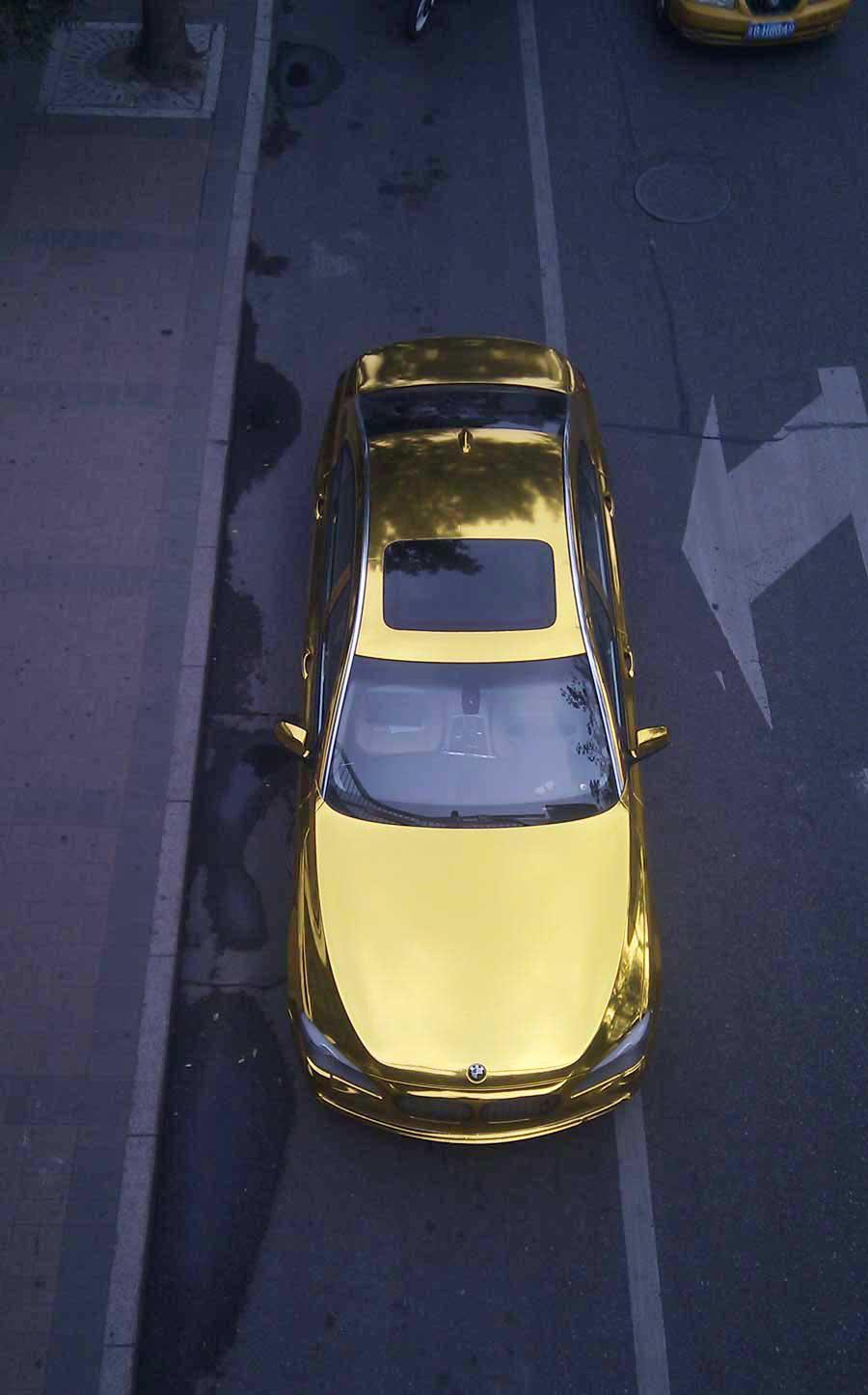 Gold BMW sedan seen in Beijing