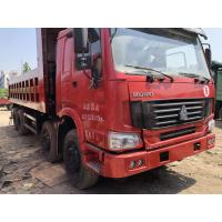 Red color self dumper sinotruk howo used dump truck with left steering